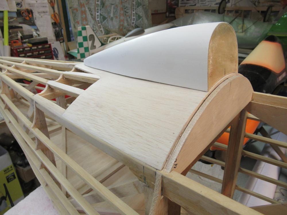 Bossage de l'appui tete en  fibre  réalisé dans un capot de roue